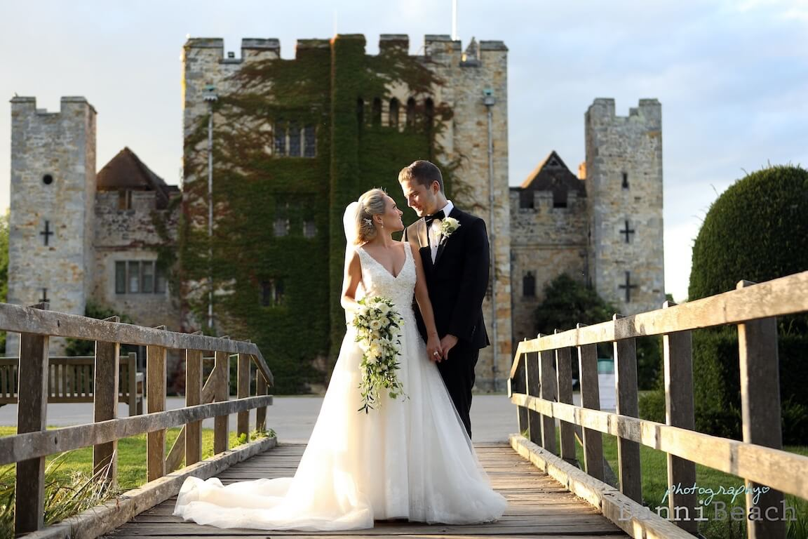 front of hever castle wedding love