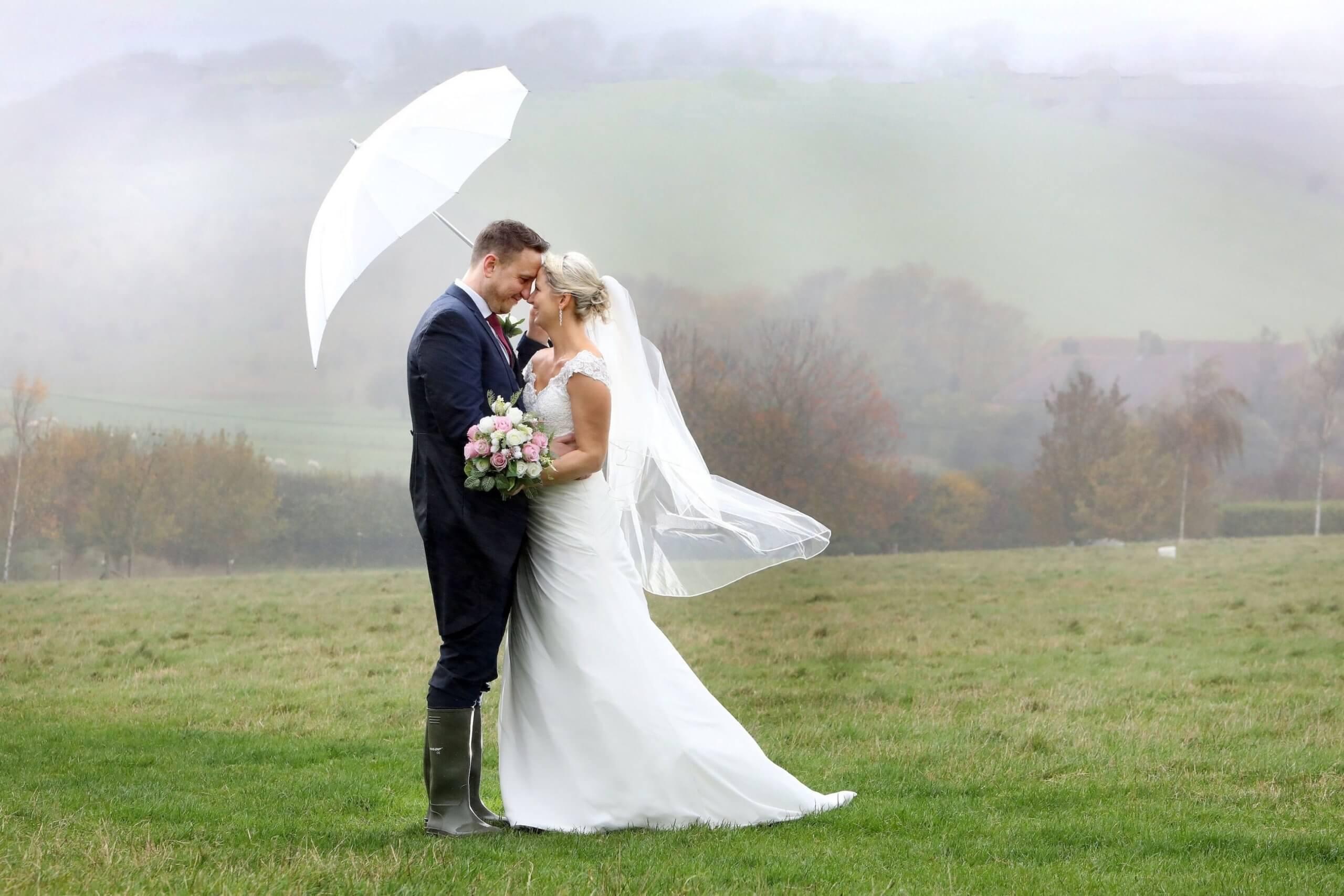 Wedding photographer Upwaltham Barns Winter umbrella