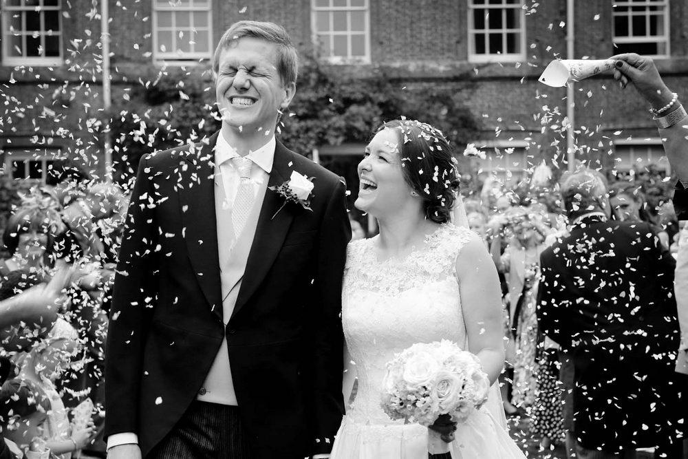 Confetti Surrey candid wedding photographer
